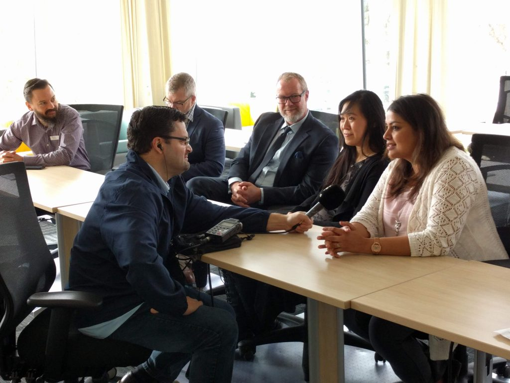 Rod Kurtz, CBC Radioactive, interviews Ed Boraas and Mike Wade of CUE's Centre for Applied Artificial Intelligence, President Tim Loreman, and Yvonne Wong (sessional instructor at CUE and entrepreneur) and Isha Katyal (manager of Centre for Innovation and Applied Research).